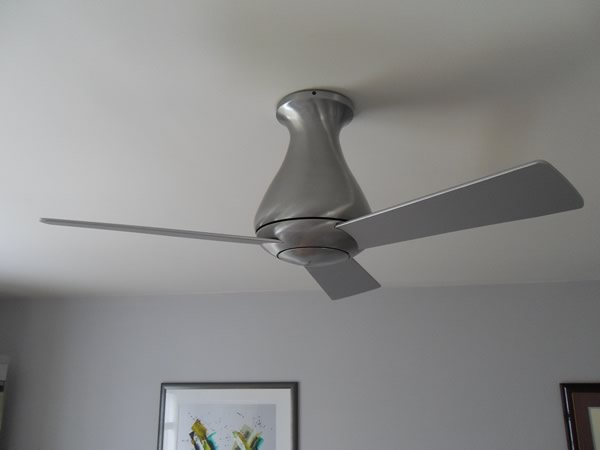 A contemperary three blade flush mount celing fan installed in Malvern, PA
